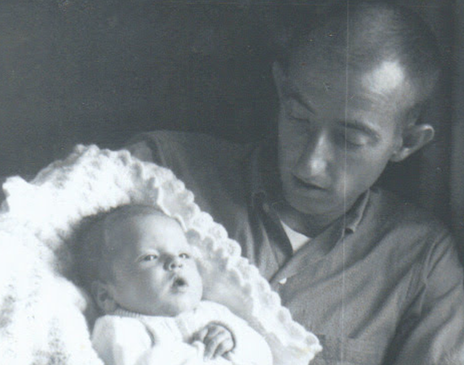 Richard Dunn as a baby, being held by his late father
